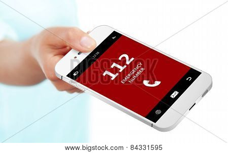 Hand Holding Mobile Phone With Emergency Number 112 Isolated Over White