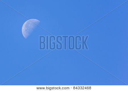 Half Moon In Blue Sky