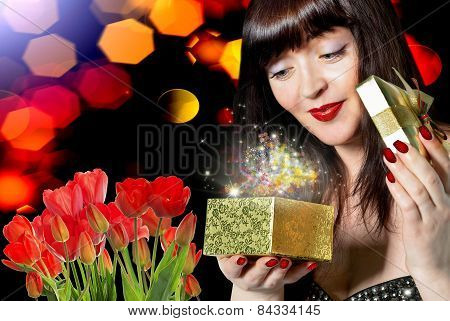 Beauty Woman With Beautiful Bouquet Fresh Red Tulips And Gift