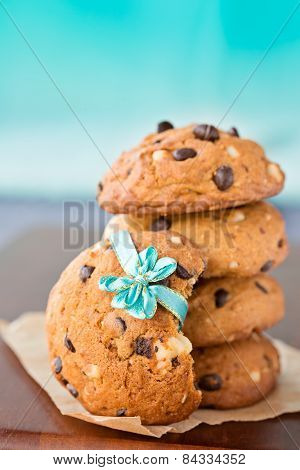 Stacked Chocolate Chip Cookies With Ribbon, On Blue Background