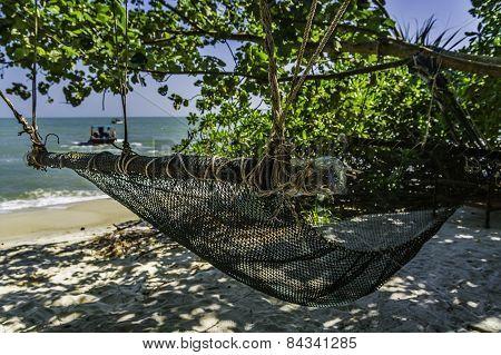 Fishing net made hammock on a beach