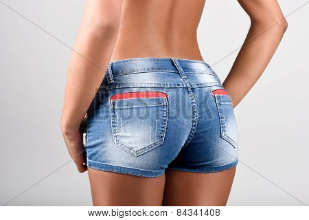 Woman Wearing Denim Shorts With A Beautiful Waist