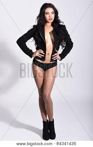 Hispanic Woman Wearing Black Jacket And Panties On White Background