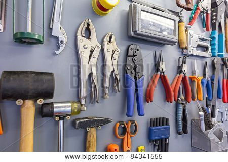 Assorted Work Tools On Garage Wall