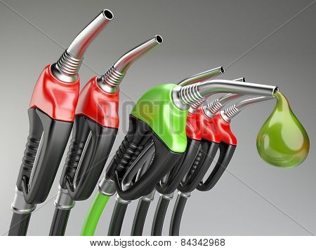 Red and green gas pump nozzle with drop oil.
