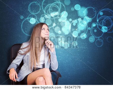 Woman in jacket, blouse sits on chair and looking up. Abstract background