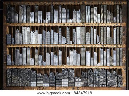 Printing Press Letter Blocks In A Wooden Shelf