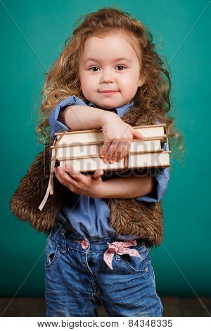 Portrait of a little girl with books in their hands.