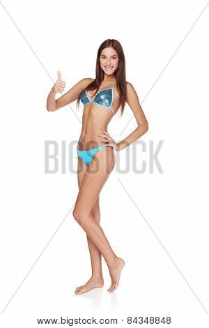 Woman in blue bikini gesturing thumb up