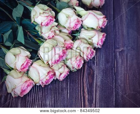 Tender Roses On Dark Recycled Wood Background
