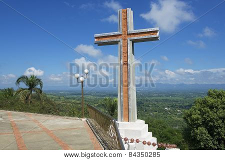 Modern cross overlooking the valley of Cibao in Santo Cerro, Dominican Republic