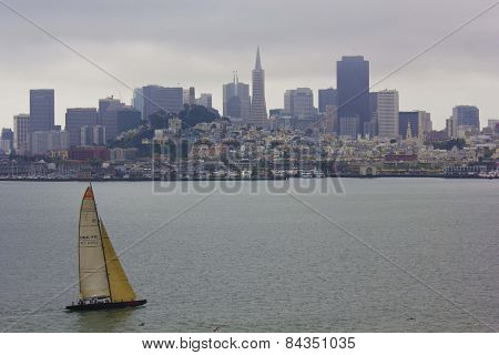 Sailing Boat On The Pacific Ocean with San Francisco Skyline