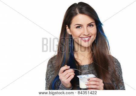 Healthy woman eating yogurt