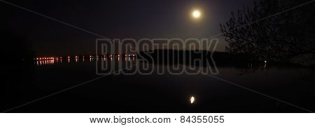 Quiet Evening At The Lake, The Moon Shines And Is Reflected In The Water