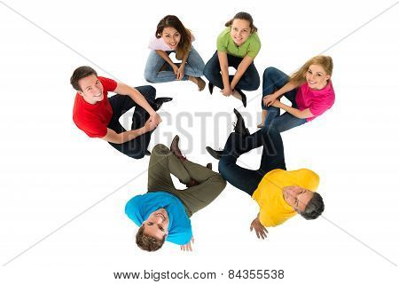 Group Of Multiethnic  Friends Sitting In A Circle