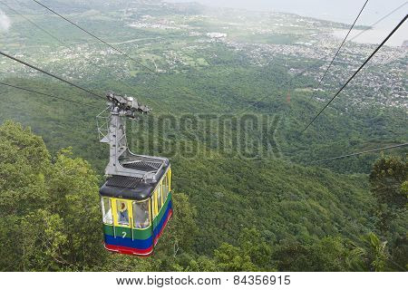 Tourists ride the cable car to the top of Pico Isabel de Torres.