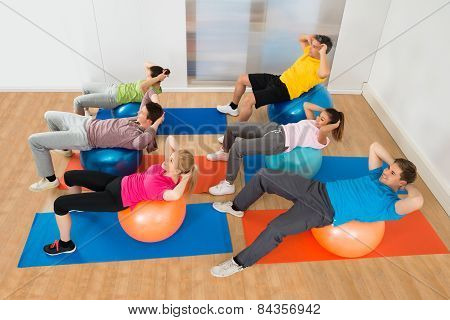 People Exercising On Pilate Ball