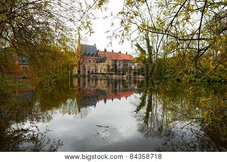 Lake of Love with medieval castle in Bruges, Belgium