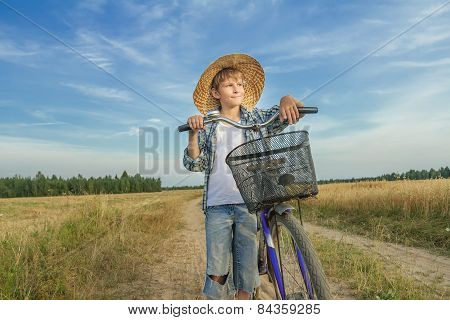 Teenager Boy With Retro Bike On Country Road