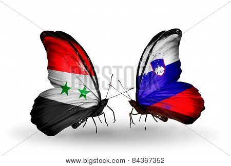 Two Butterflies With Flags On Wings As Symbol Of Relations Syria And Slovenia