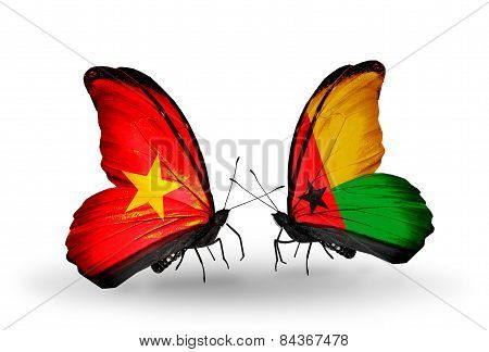 Two Butterflies With Flags On Wings As Symbol Of Relations Vietnam And Guinea Bissau