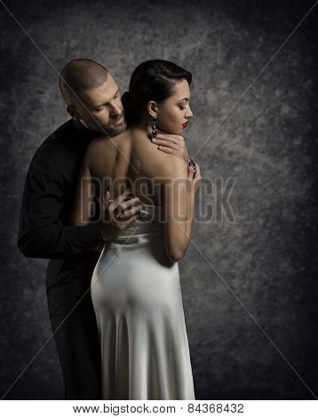 Couple Portrait, Man Woman In Love, Boy In Dark Embracing Elegant Sexy Girl In Gown With Naked Back