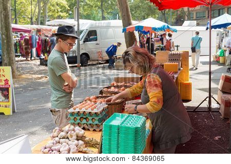 Vendor Selling Eggs At The Saint Aubin Market