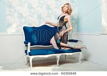 Girl Standing Knees On The Couch.