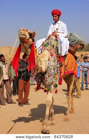 Jaisalmer, India - February 17: Unidentified Boy Rides Camel During Desert Festival On February 17,