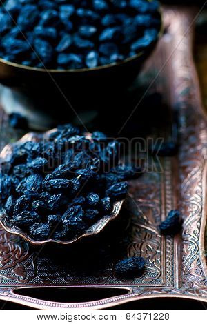Dried Dark Raisin In Oriental Metal Ware