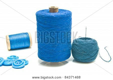 Spools Of Thread And Ball Of Black Yarn