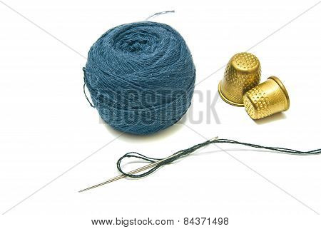Ball Of Yarn And Two Thimble