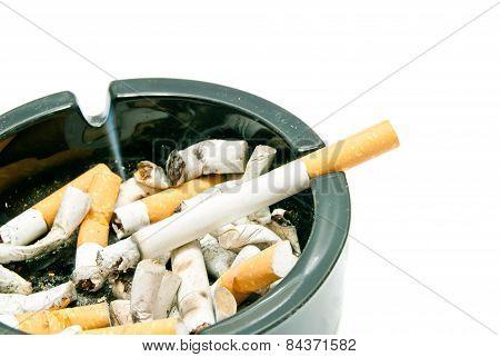 Cigarette In Black Glass Ashtray