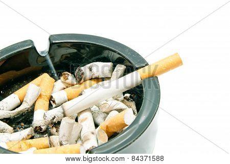 Cigarette In Black Ashtray