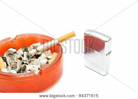 Metal Lighter And Cigarette In Ashtray