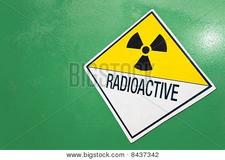Radioactive Warning Sign On A Green Container