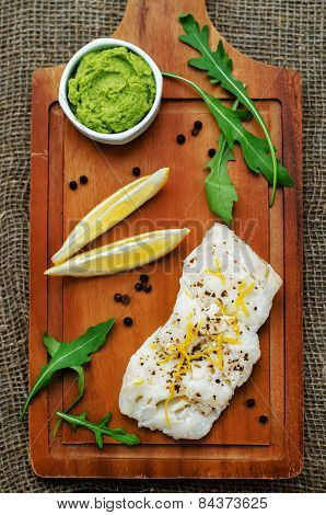 Cod Baked With Lemon And Spices With Arugula And Mashed Green Peas