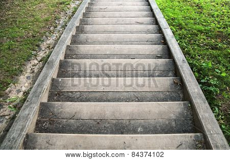Old Wooden Stairs Go Down With Green Grass