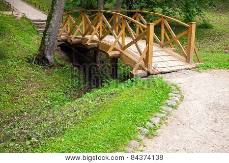 Small Wooden Bridge And Walking Lane In Park
