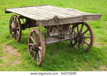 Empty Old Rural Wooden Wagon Stands On Grass