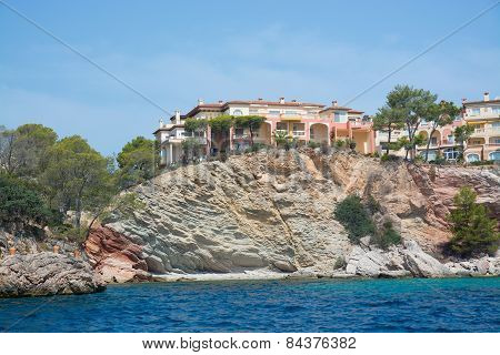 Charming hotels and apartment buildings from the sea near Cala Fornells