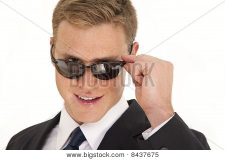 Young businessman with sunglasses and suit