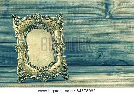 Golden Baroque Picture Fram. Retro Style Toned Picture