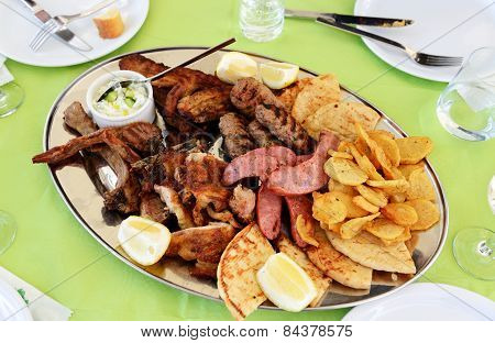 Traditional Food In The Restaurant On Santorini Island, Greece