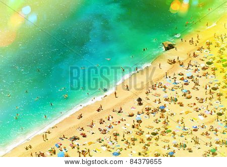Beach With Tourists, Sunbeds And Umbrellas. Holidays Background