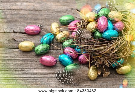 Chocolate Easter Eggs In Nest. Retro Style With Light Leaks