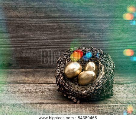 Golden Easter Eggs In Nest. Retro Style With Light Leaks