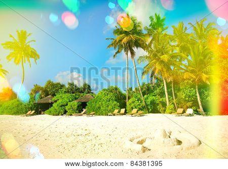 Paradise Island Sand Beach. Blue Sky With Light Leaks And Lens Flares