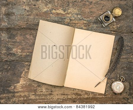 Open Diary Book And Vintage Office Supplies On Wooden Table