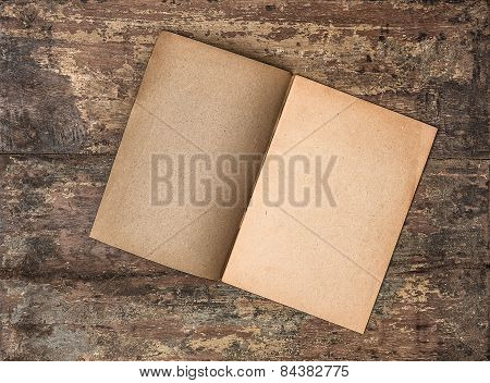 Antique Empty Journal On Grungy Wooden Background. Paper Texture